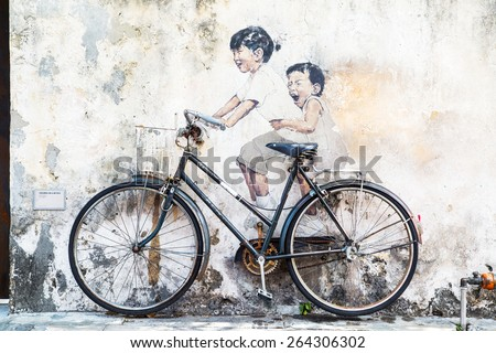 GEORGE TOWN,PENANG ,MALAYSIA- CIRCA March 26, 2015: Public street art Name Children on a bicycle painted 3D on the wall that's two little  girls riding bicycle.  in Georgetown, Penang, Malaysia. - stock photo