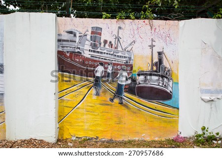 GEORGE TOWN,PENANG ,MALAYSIA- CIRCA March 26, 2015: Public street art Name Local painting on the wall by Local Artist in Georgetown, Penang, Malaysia. - stock photo