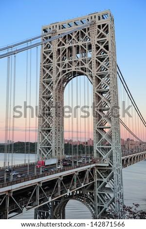 George Washington Bridge at sunset over Hudson River. - stock photo