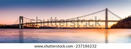 George Washington Bridge panorama above the New York skyline, at sunset - stock photo