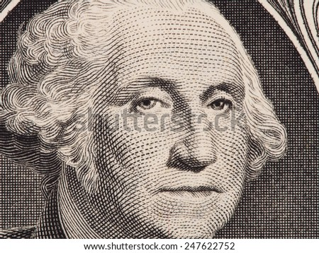 George Washington portrait on the one dollar bill closeup macro - stock photo