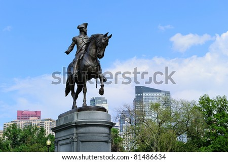 George Washington statue as the famous landmark in Boston Common Park with city skyline and skyscrapers. - stock photo