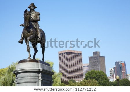 George Washington statue is the famous landmark in Boston Common Park with city skyline and skyscrapers. - stock photo