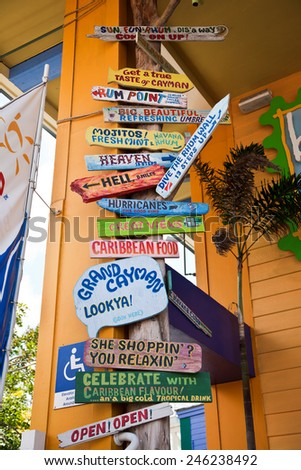 GEORGETOWN, GRAND CAYMAN - MARCH 25, 2009:  Grand Cayman is a popular travel destination in the Caribbean and this is a sign in the heart of the tourist district. - stock photo