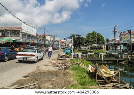 GEORGETOWN, GUYANA - AUGUST 10, 2015: View of a street and a canal in Georgetown, capital of Guyana.