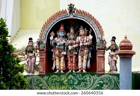 Georgetown, Malaysia - January 6, 2008:  A triptych of colorfully painted Indian deities at the Penang Nagarathar Sivan Hindu Temple  * - stock photo