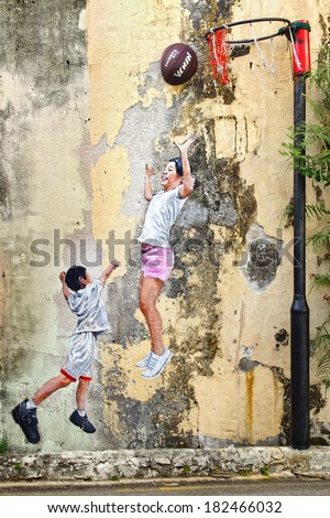 "GEORGETOWN, MALAYSIA - JANUARY 19, 2014: Street Art by artist Louis Gan ""Children Playing Ball"". It graces the wall of the Kwong Wah Yit Poh warehouse along Chulia Street Ghaut."