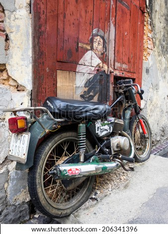 "Georgetown, Penang, Malaysia - April 24: ""Boy on a Bike"" street art mural by Lithuanian artist Ernest Zacharevic in George Town, Penang, Malaysia."