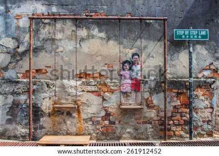 """Georgetown, Penang, Malaysia - February 19, 2015: """"Children on the Swing"""" street art on wall by local artist Louis Gan in George Town, Penang, Malaysia. - stock photo"""