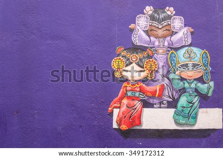 """Georgetown, Penang, Malaysia - February 18, 2015: """"Three chinese dolls on the wall"""" street art on wall in George Town, Penang, Malaysia. - stock photo"""