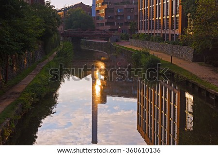 Georgetown suburb in Washington DC near the canal along Potomac River at sunrise. Canal waters with reflection against a rising sun, Washington DC, USA. - stock photo