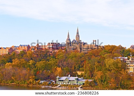 Georgetown University buildings in fall along the Potomac River. Urban scenic panorama in autumn with buildings and recreational facilities. - stock photo