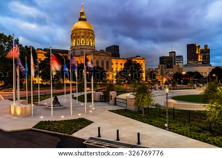 Georgia state capital and downtown Atlanta cityscape at night during blue hour