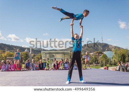 Georgia-Tbilisi.10/15/2016.On the day Tbilisoba young guys show acrobatic skills to the public.