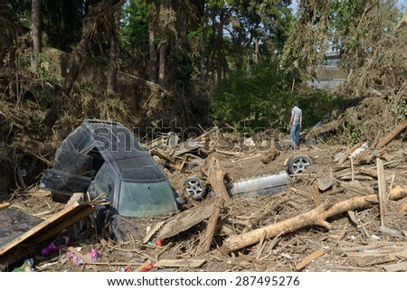 Georgia, Tbilisi, zoo. 15 june 2015: a car in a pile of debris after floods - stock photo