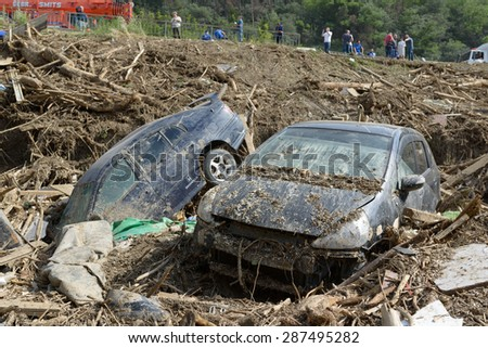 Georgia, Tbilisi, zoo. 15 june 2015: cars in a pile of rubble after mudslides - stock photo