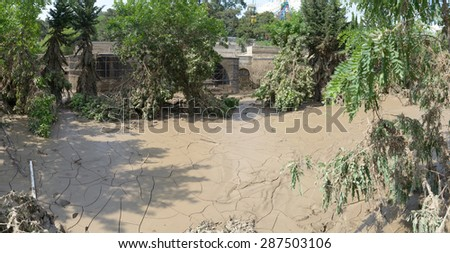 Georgia, Tbilisi, zoo. 15 june 2015: many hardened mud after flooding zoo - stock photo