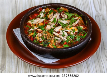 Georgian cuisine - Chahohbili - chicken with vegetables and spices - stock photo