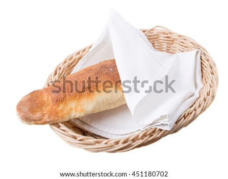 Georgian long loaf in wicker basket covered by towel. Isolated on a white background.