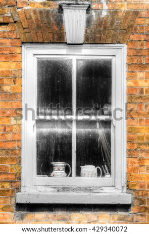 Georgian sash window with keystone against red brick wall HDR vertical photography