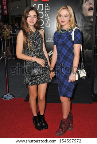 """Georgica Pettus (left) & Kathryn Newton at the world premiere of """"Insidious Chapter 2"""" at Universal Citywalk, Hollywood. September 10, 2013  Los Angeles, CA - stock photo"""