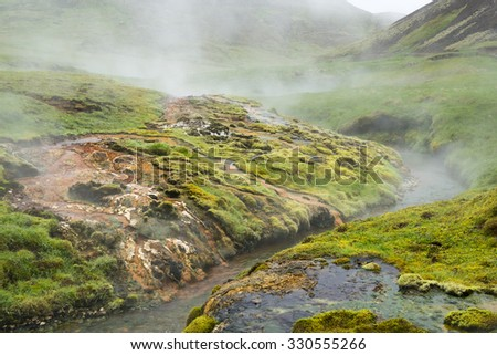 Geothermal valley of hot springs near Hveragerdi town, thermal river, Iceland - stock photo