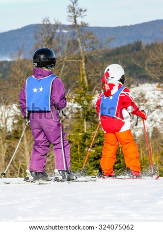 GERARDMER, FRANCE - FEB 17 - French children form ski school groups during the annual winter school holiday on Feb 17, 2015 in Gerardmer, France. - stock photo