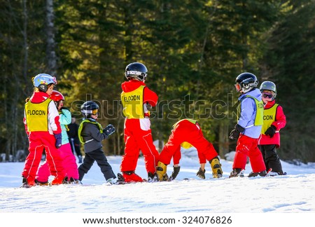 GERARDMER, FRANCE - FEB 19 - French children form ski school groups during the annual winter school holiday on Feb 19, 2015 in Gerardmer, France. - stock photo