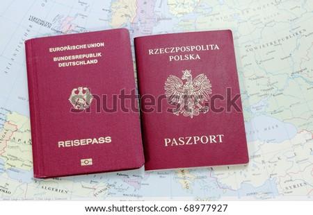german and polish passport on the map - stock photo