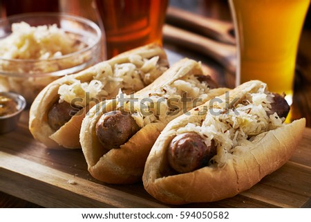german bratwursts and sauerkraut with beer