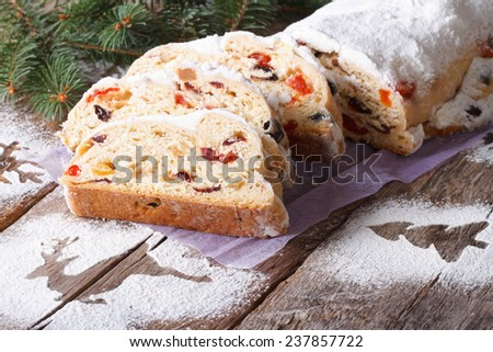 German Christmas fruit cake Stollen close-up on the table. horizontal  - stock photo