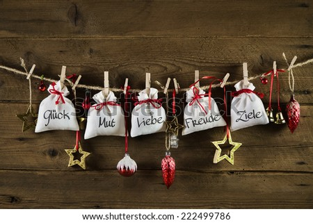 German christmas greeting card with presents: luck, courage, love, joy, aims. - stock photo