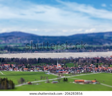 German countryside and village with tilt shift toy effect shallow depth of field. Bavaria, Germany - stock photo