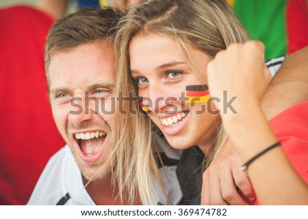 German Couple at Stadium - stock photo