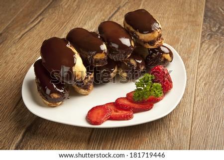 German Dessert _ ekler pasta turkish - stock photo