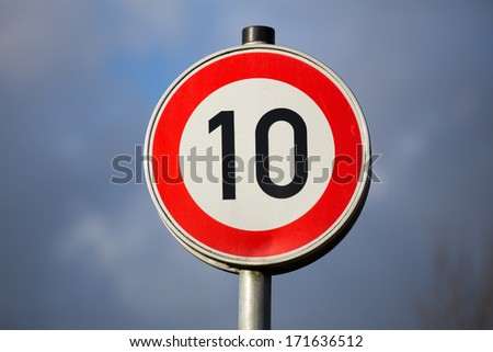 german drive only ten kilometer sign - stock photo
