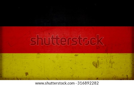 German flag painted on a stone wall texture