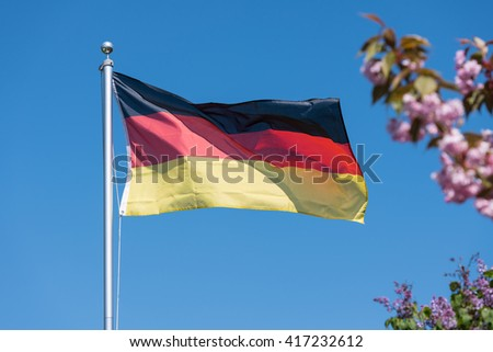 German flag. The German flag blowing in the wind on a clear blue day in spring.