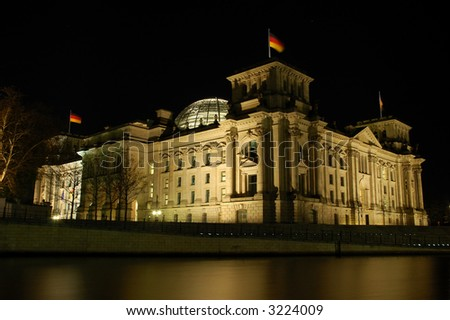 German Parliament Building the Reichstag illuminated at Night, Berlin Germany - stock photo