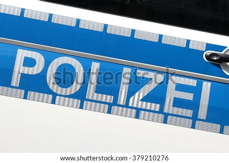 German police car (translation: police) - stock photo