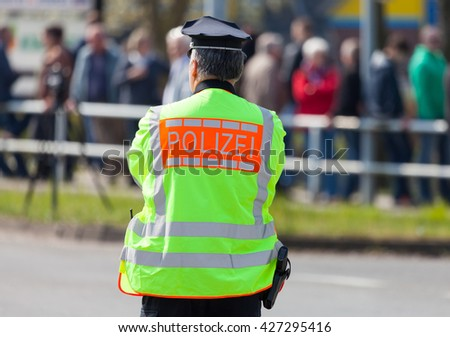 german police officer stands on street - stock photo