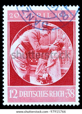 GERMAN REICH - CIRCA 1940: A stamp printed in Germany shows image of Adolf Hitler and girl, circa, 1940 - stock photo