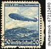 German Reich - CIRCA 1936: Airmail Stamp printed in German Reich shows Zeppelin LZ 129 Hindenburg above North America - stock photo
