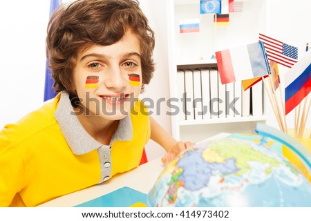 German schoolboy learning geography at the class - stock photo