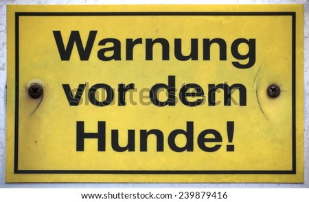German sign meaning: Beware of the dog. - stock photo