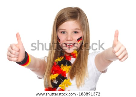 german soccer fan holding thumbs up - stock photo