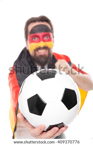 German soccer fan is cheering, Football in the front, isolated on white - stock photo