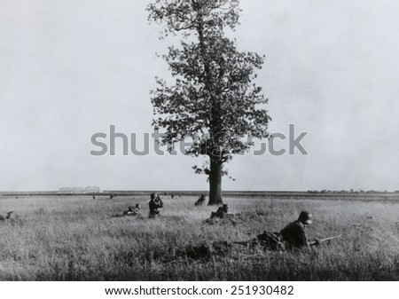 German soldiers advance on Witrunljn, during the Nazi invasion of the Soviet Union (Russia). Summer 1941, World War 2. - stock photo
