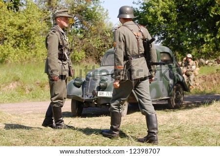 German soldiers and car. WW2 reenacting