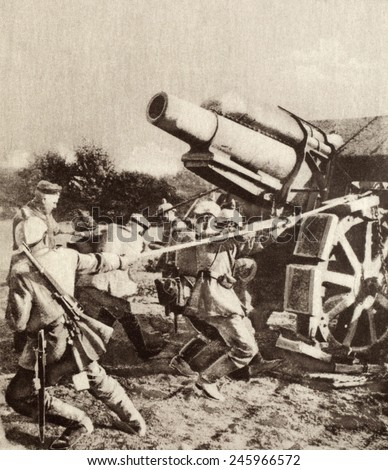 German soldiers strain to move a huge siege gun into an attack position. The massive gun was designed shortly before WWI, to defeat strongest fortifications, such as those at Liege, Belgium. 1914-18. - stock photo
